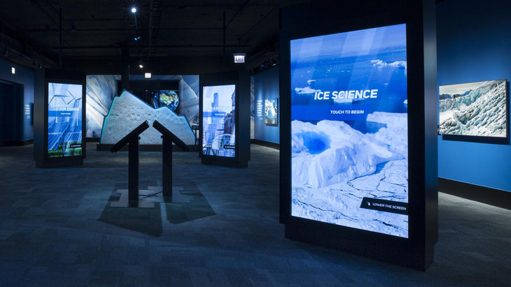 View of the Extreme Ice exhibit gallery including mounted photos and interactive panels.